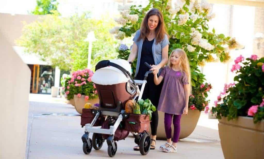 Ellen and her kid using a comfortable umbrella stroller.
