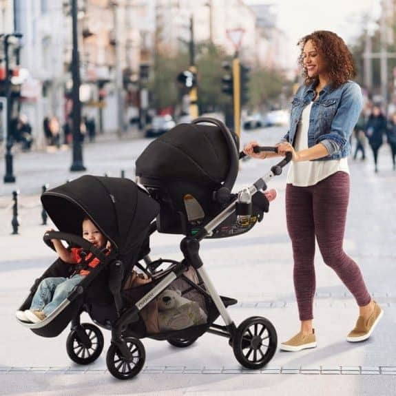 Jolynn walking with her children in a double stroller.