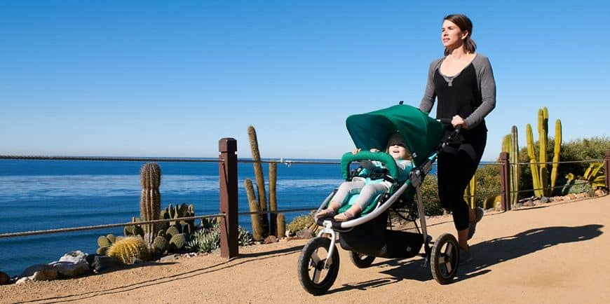 Heather walking with her son in a jogging stroller.