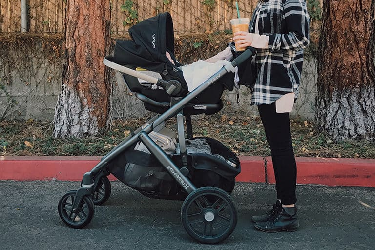 Christina and her daughter about to go for a walk with her new Kolcraft Cloud.