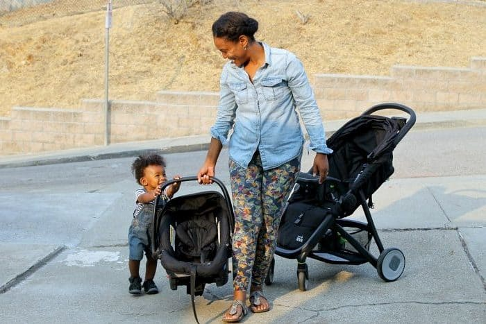 Ruth and her son walking with a double stroller travel system.